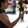 street juggler wearing a red nose in the centre of Montpellier,Languedoc, southern France