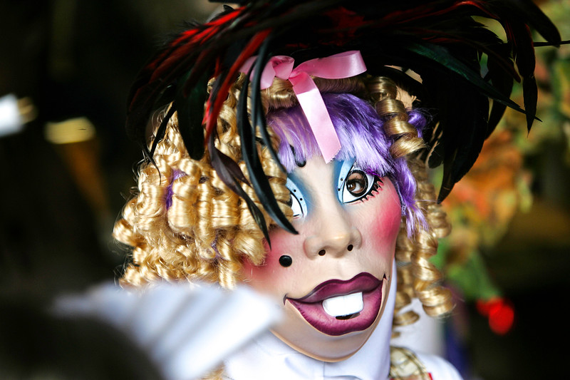 masked and costumed participants in the traditional annual carnival at Limoux ,Languedoc, southern France
