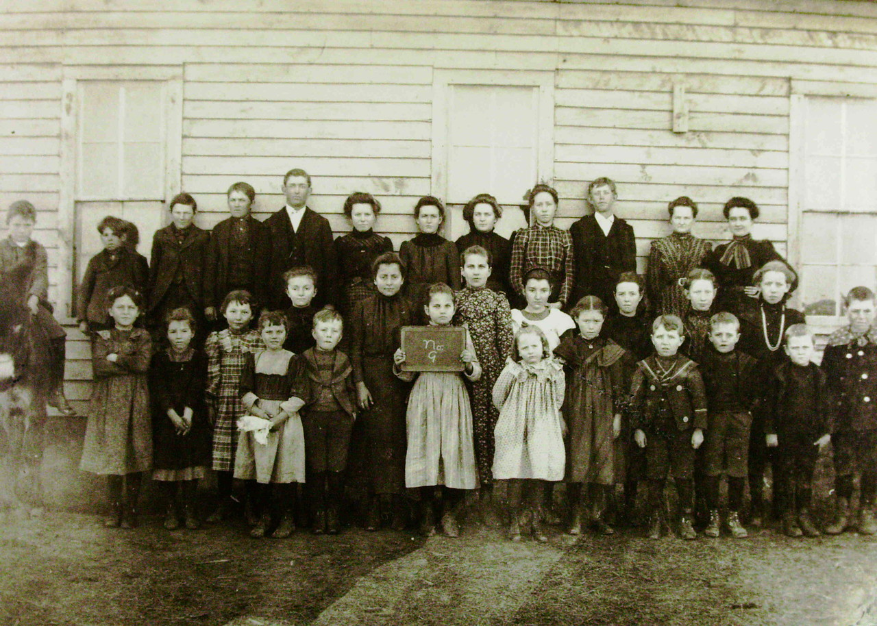 Meikle School photo taken in 1901.  Emily Kucera Burlie, Bessie Lanie's mother, is behind the girl holding the slate and is wearing a printed dress.