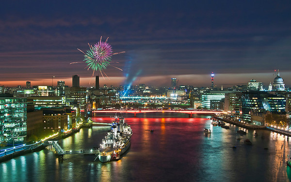 Lord Mayors show fireworks, over London Bridge and the HMS Belfast. River Thames, London.