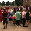MARK ROBARGE - MROBARGE@TROYRECORD.COM<br /> Graduates and wellwishers alike wait to get inside Lansingburgh High School on Friday night for the school's 115th Commencement.