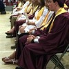 MARK ROBARGE - MROBARGE@TROYRECORD.COM<br /> Graduates listen to valedictorian Rachely Sanchez-Murray's speech during Lansingburgh High School's 115th Commencement on Friday night.