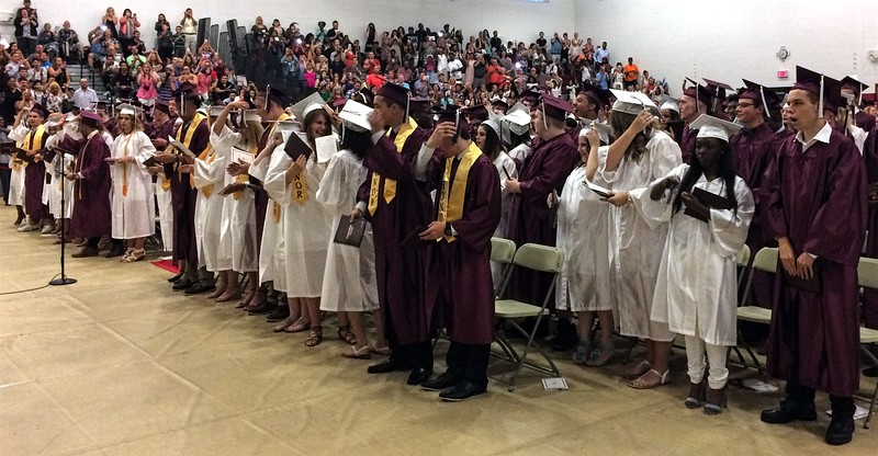 MARK ROBARGE - MROBARGE@TROYRECORD.COM<br /> Members of the Class of 2017 move the tassels on their mortarboards to conclude Lansingburgh High School's 115th Commencement on Friday night.