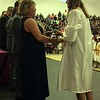 MARK ROBARGE - MROBARGE@TROYRECORD.COM<br /> Salutatorian Calysta Laport receives her diploma from Lansingburgh Central School District Superintendent Cynthia DeDomenick during Lansingburgh High School's 115th Commencement on Friday night.