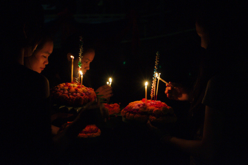 At the end of the procession, tourists and Luang Prabang residents made their way to the river to send off a candle boat