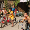All the kids ride bikes in Laos!