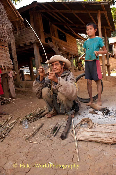 An Elderly Khmu Man Fashions Bird Snares In Lao People's Democratic Republic