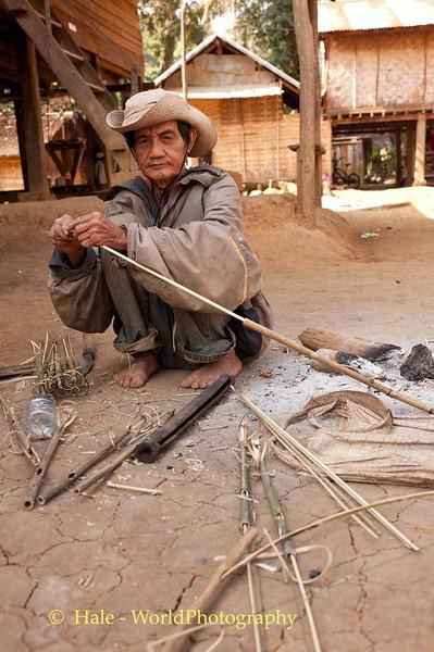 Khmu Villager Crafting A Bird Snare