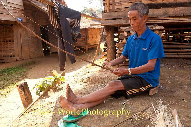 Khmu Man Testing A Rat Snare That He Is Making
