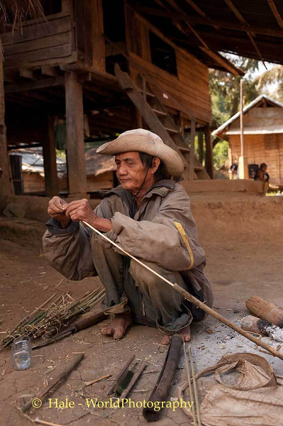 An Elderly Khmu Man Fashions A Bird Snare