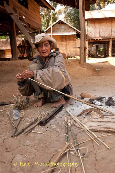 Khmu Man Making A Bird Snare