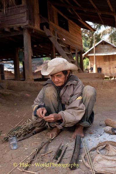 A Khmu Man Making A Bird Snares In Laos
