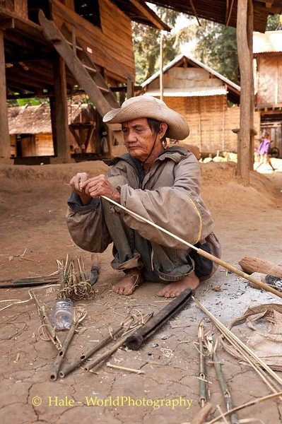 Khmu Villager Making A Bird Snare