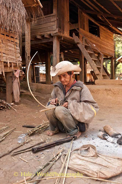 Khmu Man Tests A Bird Snare
