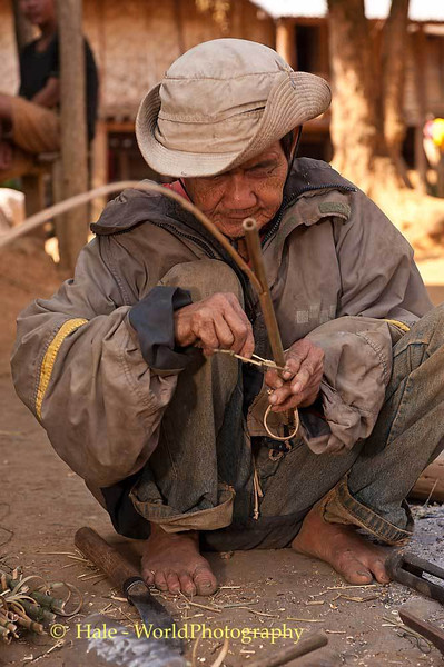 An Elderly Khmu Villager Makes A Bird Snare