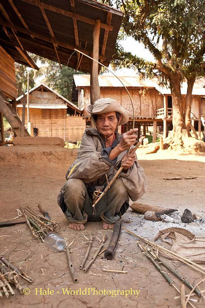 An Elderly Khmu Man Making A Bird Snare