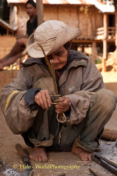 An Elderly Khmu Man Making A Bird Snare In Laos