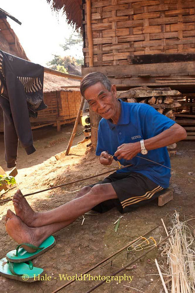 Khmu Man Making A Rat Snare