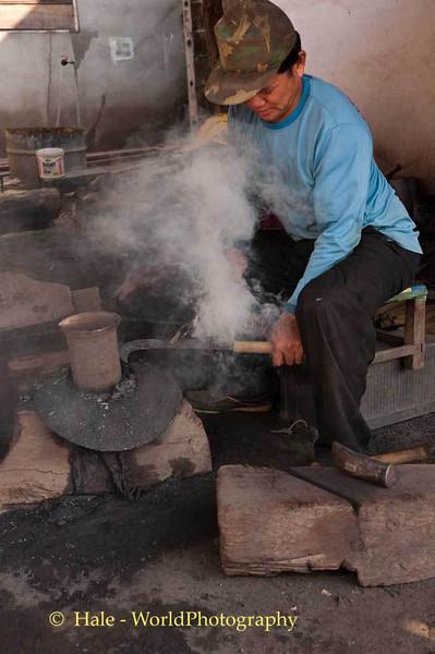 Burning Bamboo Handle On To Knife