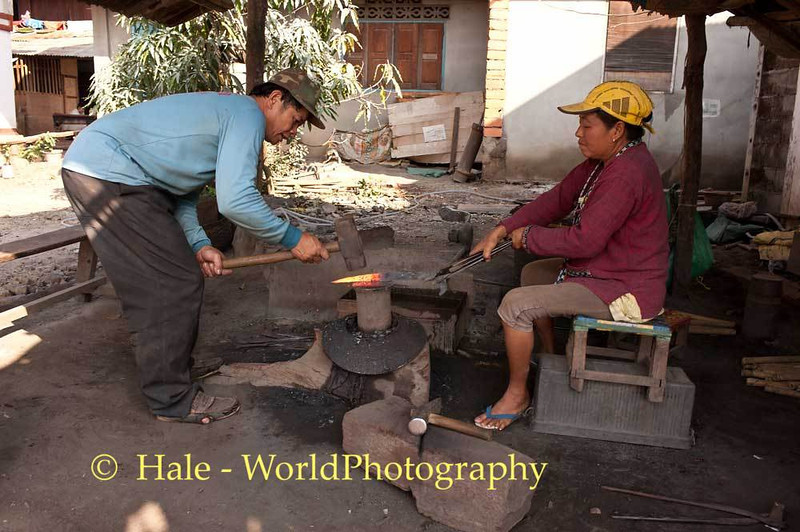 Husband and Wife Blacksmiths Working In Ban Hat Hien