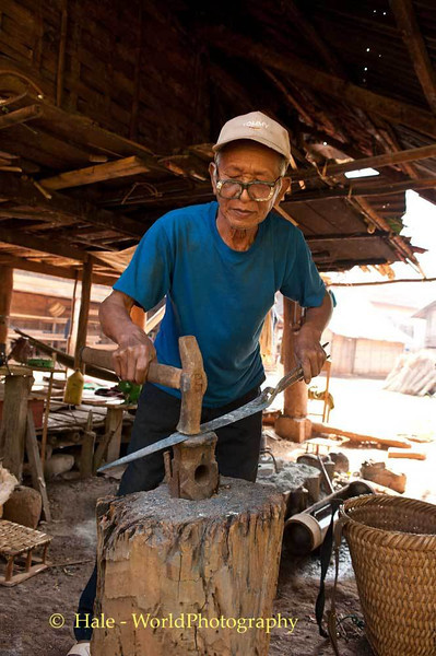 A Khmu Blacksmith Making A Knife