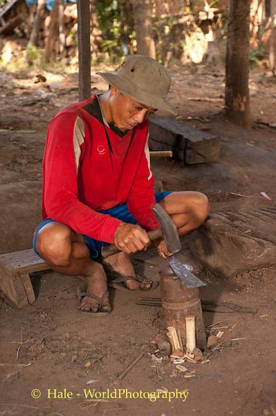 A Blacksmith Works On A Knife For A Customer