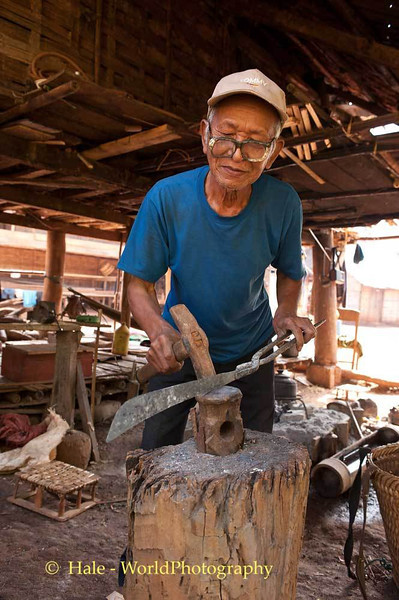 An Old Blacksmith Works the Steel