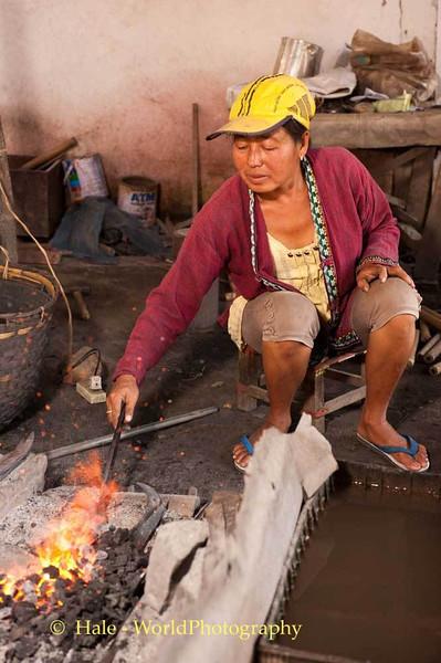 Blacksmith Wife Heats the Steel