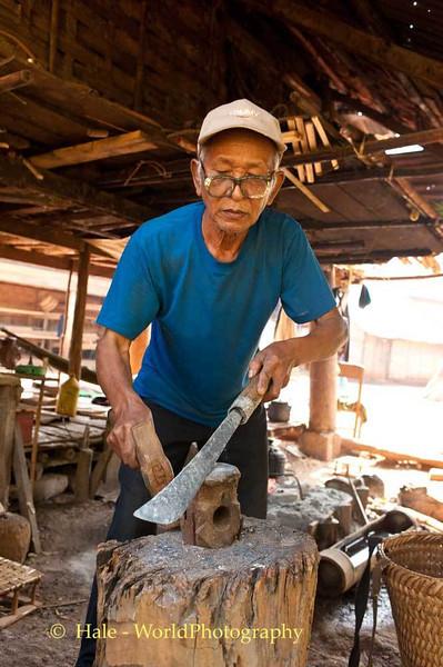 A Khmu Blacksmith Making A Knife In His Village