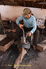 Blacksmith Works On Knife At His Home Forge