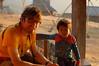 Laos, Vieng Phou Kha, Akha Trail: Yann and his admirer hang out at our hut