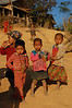 Laos, Vieng Phou Kha, Akha Trail: Children running around at dusk
