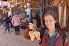 Laos, Oudom Xay: Emilie very happy to have found some excellent roots from a vendor.