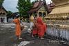 Saffron-robed monks with alms baskets