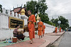 Young monks at the alms giving ceremony, Wat Sene, Luang Prabang, Loas