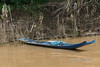 Blue fishing boat on the Mekong River, downstream of Luang Prabang, Laos