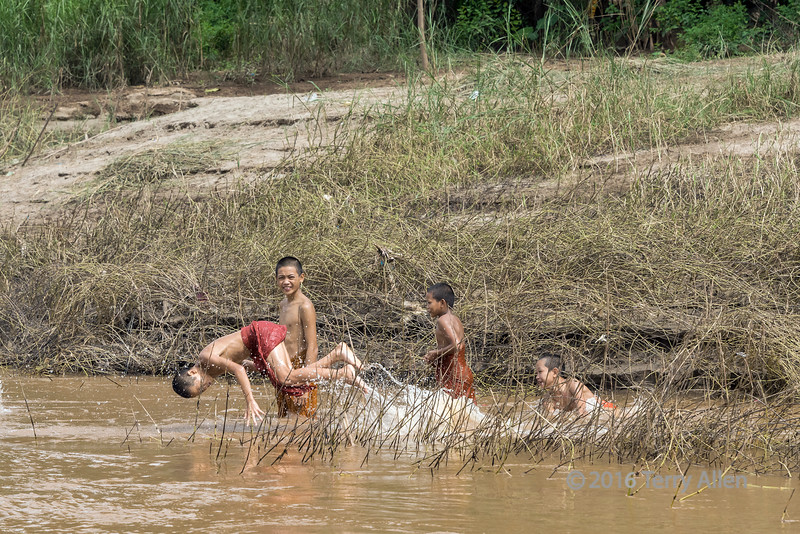 Boys playing in the Mekong River, downstream from Luang Prabang, Laos