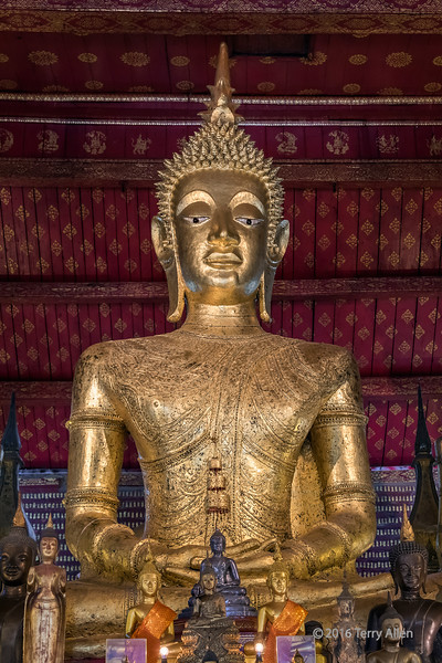 Gilded Buddha seated in the lotus position, Wat Mai temple, Luang Prabang, Laos