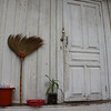 "A broom, bucket & planet beside a white door in Luang Prabang, Laos.  Travel photo from Luang Prabang, Laos. <a href=""http://nomadicsamuel.com"">http://nomadicsamuel.com</a>"