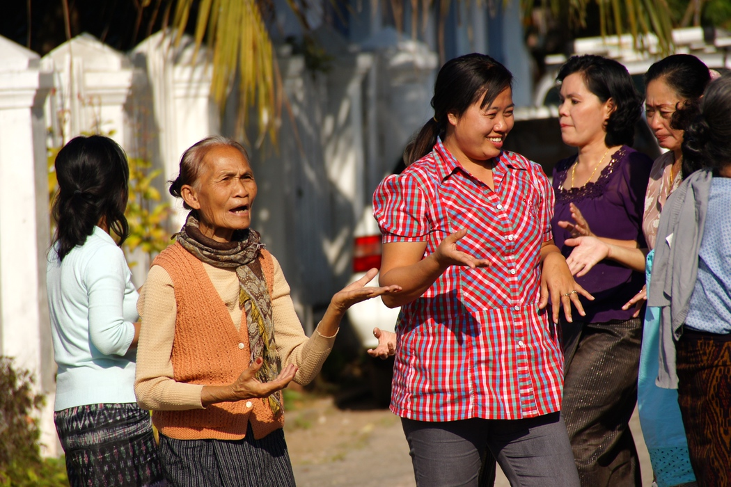 Ladies dancing during the afternoon on the side street - Luang Prabang, Laos.  This is a travel photo from Luang Prabang, Laos.