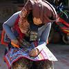 "A lady wearing ethnic attire making handicrafts - Luang Prabang, Laos.  This is a travel photo from Luang Prabang, Laos. <a href=""http://nomadicsamuel.com"">http://nomadicsamuel.com</a>"