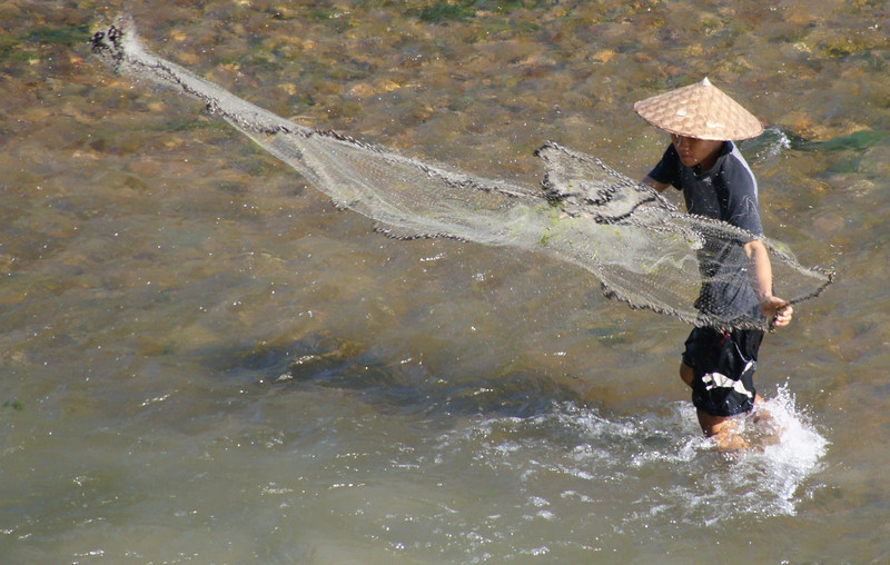 "A local Laos fisherman casting his fishing net - Luang Prabang, Laos.  This is a travel photo from Luang Prabang, Laos.  To purchase this photo click on it or to view the rest of my gallery from Luang Prabang, Laos click here. <a href=""http://nomadicsamuel.com"">http://nomadicsamuel.com</a>"