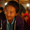 "A cheerful vendor at the night market - Luang Prabang, Laos.  This is a travel photo from Luang Prabang, Laos. <a href=""http://nomadicsamuel.com"">http://nomadicsamuel.com</a>"