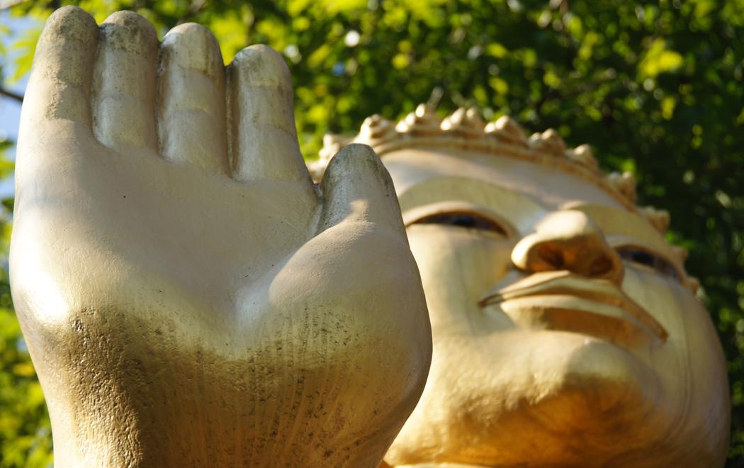 Buddha's hand and face atop mount Phousi - Luang Prabang, Laos.  Travel photo from Luang Prabang, Laos.
