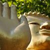 "Buddha's hand and face atop mount Phousi - Luang Prabang, Laos.  Travel photo from Luang Prabang, Laos. <a href=""http://nomadicsamuel.com"">http://nomadicsamuel.com</a>"