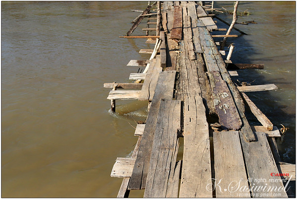 Wooden bridge crossing to U-mong Village