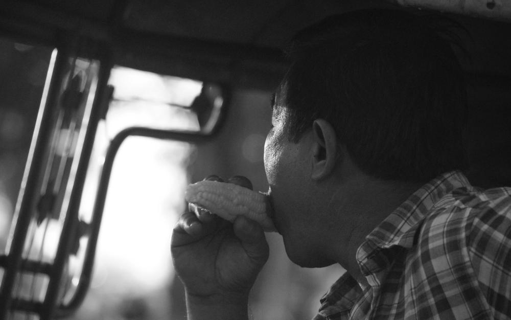 Laos Man Eating Corn | Vientiane, Laos | Travel Photo