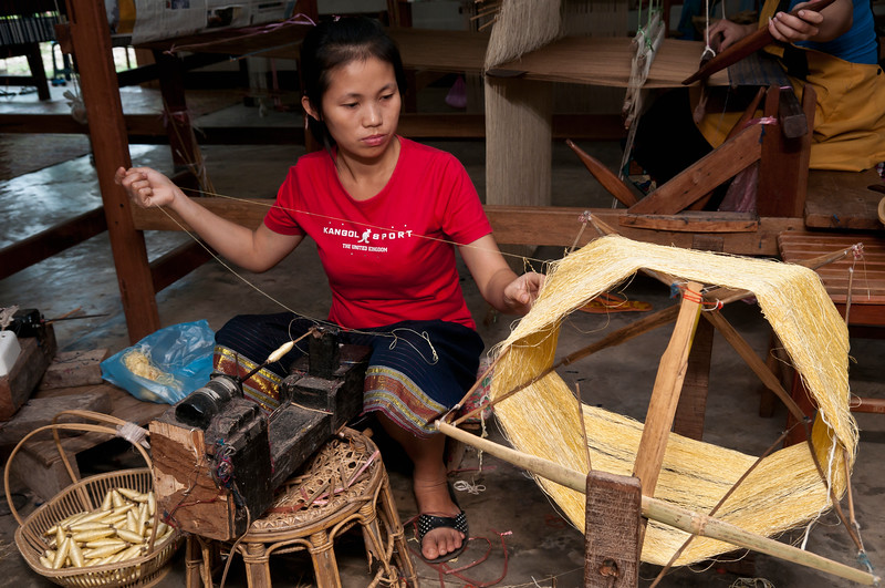 Woman spins silk thread at The Houey Hong Vocational Training Centre for Women near Vientiane, Laos.