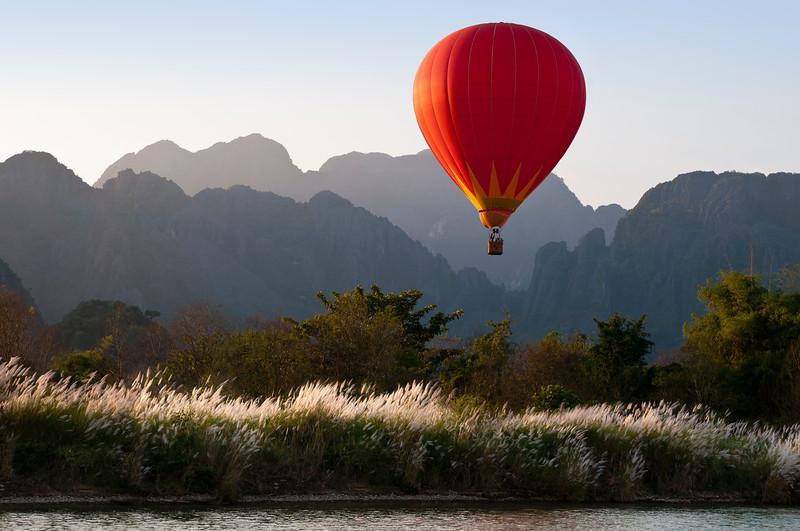 Hot air balloon floats by Nam Song River, Vang Vieng, Laos