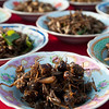 Fried grasshoppers for sale at That Luang festival, Vientiane, Laos.